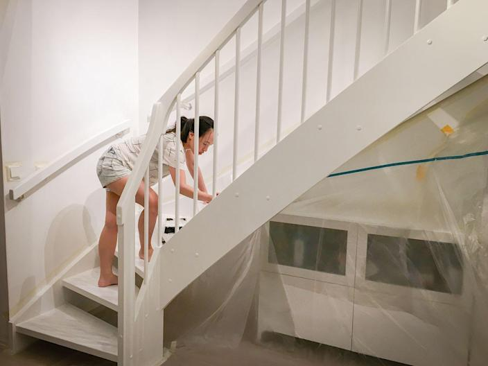 """<p>Staircase remodeling can cost a lot, and this trick will save you money if you do it yourself. Sarah Logan, editor of <a href=""""https://thebunnyhub.com/"""" rel=""""nofollow noopener"""" target=""""_blank"""" data-ylk=""""slk:The Bunny Hub"""" class=""""link rapid-noclick-resp"""">The Bunny Hub</a>, recommends that you paint your staircase so that it looks like it has a carpet runner. """"This gives you the cozy look and feel of a carpet, without the maintenance of owning a carpet,"""" she says.<br></p><p>If you're going to take on this task, remember that painting can be a bit of a messy job. """"Although we cover furniture and wear old clothes, often people forget about their phone,"""" says Jen Stark, founder of <a href=""""https://happydiyhome.com/"""" rel=""""nofollow noopener"""" target=""""_blank"""" data-ylk=""""slk:Happy DIY Home"""" class=""""link rapid-noclick-resp"""">Happy DIY Home</a>. """"Place your phone in a simple plastic Ziplock, bag and it will stay paint-free and you can still use the screen.""""</p>"""