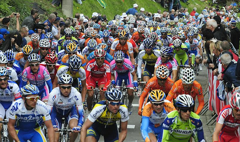 The pack rides in the uphill of Huy on April 22 2009 during the Fleche Wallonne mens cycling race between Charleroi and Hui AFP PHOTO DOMINIQUE FAGET Photo credit should read DOMINIQUE FAGETAFP via Getty Images