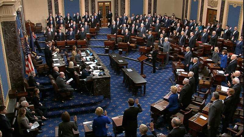 Chief Justice John Roberts swears in members of the Senate for the impeachment trial against President Trump at the U.S. Capitol in Washington, D.C., Thursday. (Senate Television via AP)