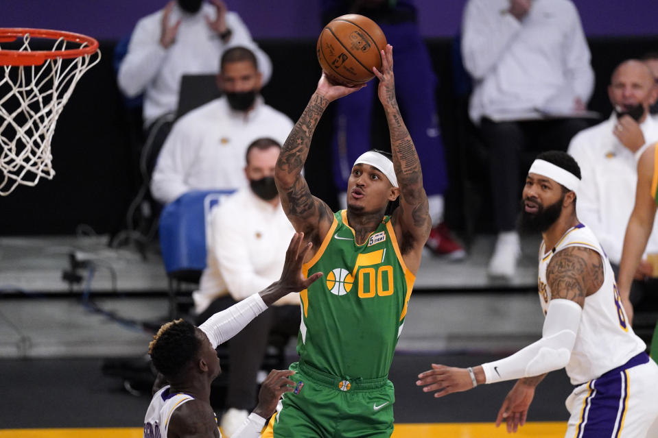 Utah Jazz guard Jordan Clarkson, center, shoots as Los Angeles Lakers guard Dennis Schroder, left, and forward Markieff Morris defend during the first half of an NBA basketball game Saturday, April 17, 2021, in Los Angeles. (AP Photo/Mark J. Terrill)