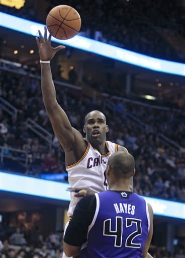 Cleveland Cavaliers' Antawn Jamison shoots over Sacramento Kings' Chuck Hayes in the fourth quarter in an NBA basketball game Sunday, Feb. 19, 2012, in Cleveland. The Cavaliers won 93-92. (AP Photo/Tony Dejak)