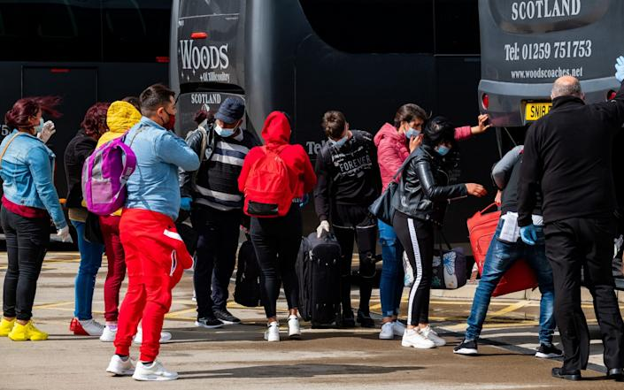 170 migrant workers from Romania and Bulgaria arrived on a charter flight into Edinburgh Airport in May  - Stuart Nicol/Stuart Nicol Photography