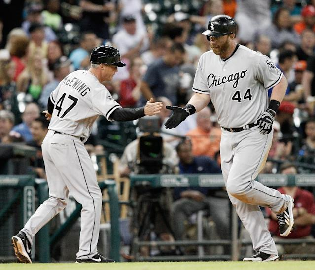Chicago White Sox's Adam Dunn (44) is congratulated by third base coach Joe McEwing (47) after hitting a three-run home run in the sixth inning against the Houston Astros during a baseball game on Friday, May 16, 2014, in Houston. (AP Photo/Bob Levey)