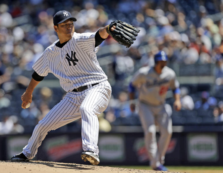 New York Yankees starting pitcher Hiroki Kuroda, of Japan, delivers during the fourth inning of a baseball game against the Los Angeles Dodgers Wednesday, June 19, 2013, in New York. (AP Photo/Kathy Willens)