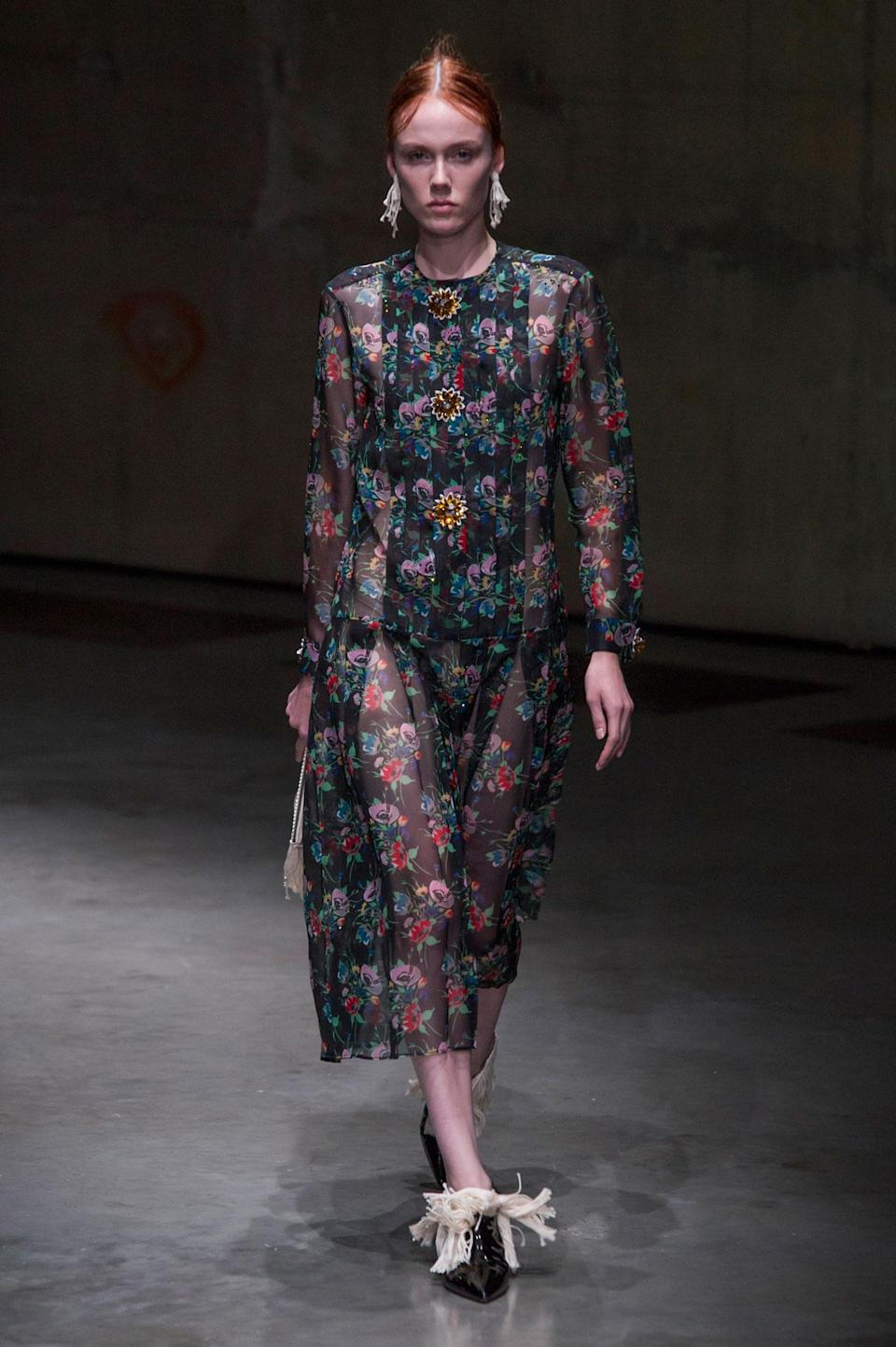 <p>Sheer black, green and red floral dress from the SS18 Christopher Kane collection. (Photo: ImaxTree) </p>
