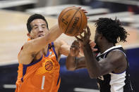 Phoenix Suns guard Devin Booker, left, blocks a pass intended for Los Angeles Clippers guard Patrick Beverley during the first half in Game 3 of the NBA basketball Western Conference Finals Thursday, June 24, 2021, in Los Angeles. (AP Photo/Mark J. Terrill)