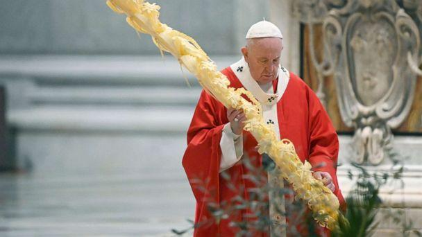 PHOTO: Pope Francis holds a palm branch as he celebrates Palm Sunday Mass behind closed doors in St. Peter's Basilica, at the Vatican, April 5, 2020, during the lockdown aimed at curbing the spread of the COVID-19 infection. (Alberto Pizzoli/AP)
