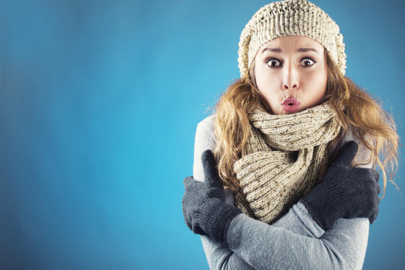 Young woman with scarf beret and glove shivering
