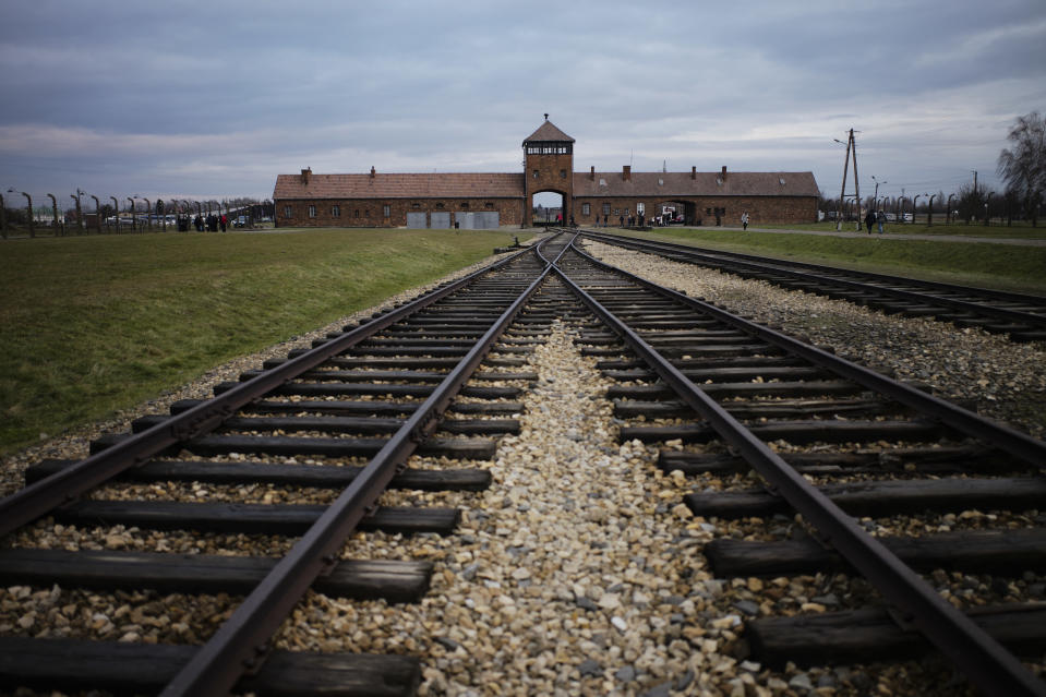 FILE - In this Saturday, Dec. 7, 2019 photo the railway tracks where hundred thousands of people arrived to be directed to the gas chambers inside the former Nazi death camp of Auschwitz Birkenau, or Auschwitz II, are pictured in Oswiecim, Poland. (AP Photo/Markus Schreiber, file)
