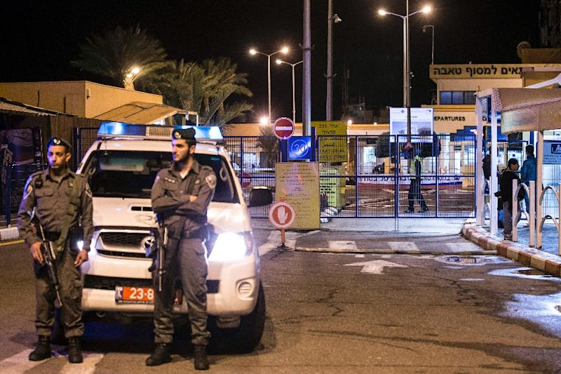 An Israeli police car blocks the road on the Israeli side of the Taba crossing leading into Egypt on February 16, 2014