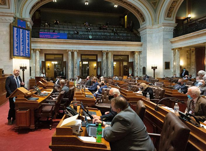 Majority Leader Jim Steineke, left, R-Kaukauna, speaks during debate on Assembly Bill 24 at the state Capitol in Madison on Tuesday. The bill would bar health officials from requiring places of worship to close buildings during disease outbreaks like the coronavirus pandemic. Under Evers' stay-at-home order issued last spring, churches and other places of worship were required to close to the public and instead offer virtual services to prevent the spread of COVID-19.