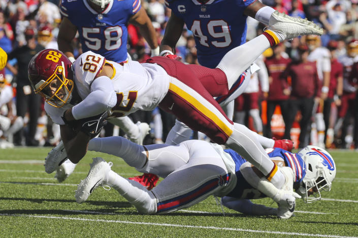 Washington Football Team's Logan Thomas (82) is tackled by Buffalo Bills' Micah Hyde (23) during the first half of an NFL football game Sunday, Sept. 26, 2021, in Orchard Park, N.Y. (AP Photo/Jeffrey T. Barnes)