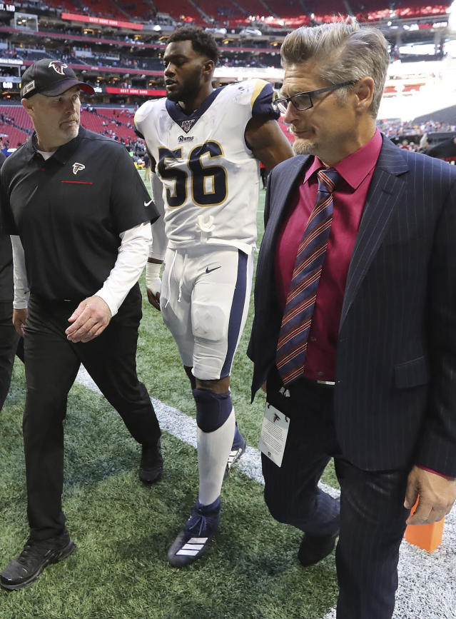 Atlanta Falcons head coach Dan Quinn, left, and general manager Thomas Dimitroff, right, walk off the field after falling to the Los Angeles Rams in an NFL football game on Sunday, Oct. 20, 2019, in Atlanta. (Curtis Compton/Atlanta Journal-Constitution via AP)