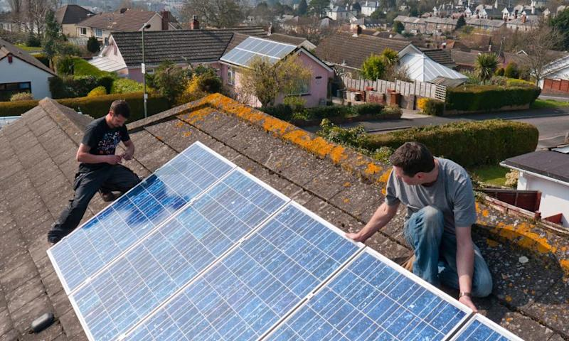 Solar panels being installed on a house