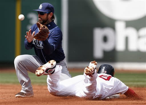 Boston Red Sox's Shane Victorino, right, steals second base as Tampa Bay Rays' Ryan Roberts can't handle the throw in the third inning of a baseball game in Boston, Saturday, April 13, 2013. (AP Photo/Michael Dwyer)