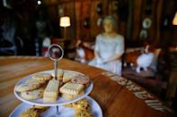 """Short bread is placed in front of Queen Elizabeth model at the British curiosity collection called """"Little Britain"""" of Gary Blackburn, a 53-year-old tree surgeon from Lincolnshire, Britain, in Linz-Kretzhaus, south of Germany's former capital Bonn, Germany, August 24, 2017. Picture taken August 24, 2017. REUTERS/Wolfgang Rattay"""