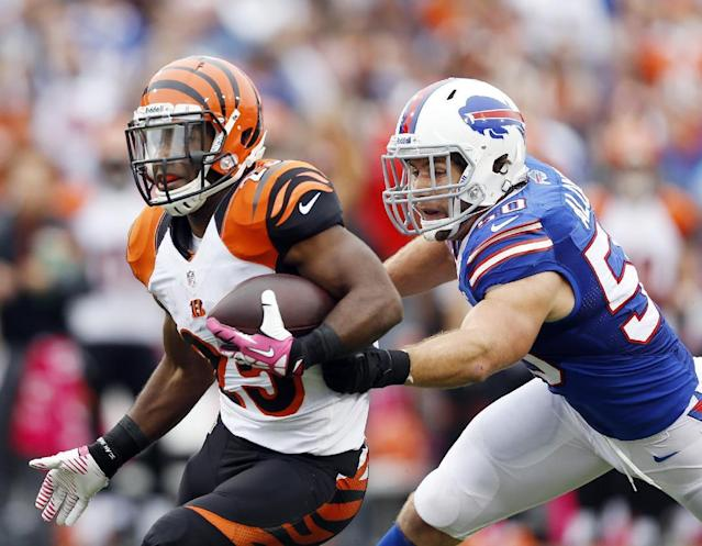 FILE - In this Oct. 13, 2013, file photo, Cincinnati Bengals' Giovani Bernard (25) runs downfield as Buffalo Bills' Kiko Alonso closes in during the second half of an NFL football game in Orchard Park, N.Y. General manager Doug Whaley announced that Alonso had been hurt with what the team fears to be a serious knee injury while working out in Oregon released in a statement by the team Tuesday, July 1, 2014. (AP Photo/Gary Wiepert File)