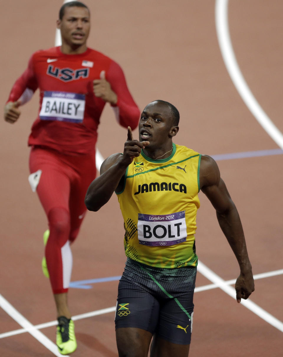 Jamaica's Usain Bolt celebrates after crossing the finish line to win gold in the men's 100-meter final during the athletics competition in the Olympic Stadium at the 2012 Summer Olympics, Sunday, Aug. 5, 2012, in London. (AP Photo/Matt Slocum)