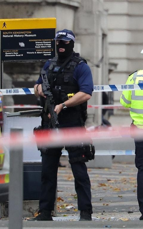 An armed Metropolitan Police officer outside the Natural History Museum in west London on Saturday - Credit: J Almasi/BACKGRID