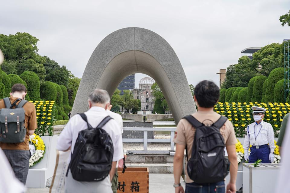 HIROSHIMA, JAPAN - 2020/08/06: People praying at the Hiroshima Peace Memorial Ceremony. Hiroshima marks the 75th anniversary of the U.S. atomic bombing which killed about 150,000 people and destroyed the entire city during World War II. (Photo by Jinhee Lee/SOPA Images/LightRocket via Getty Images)