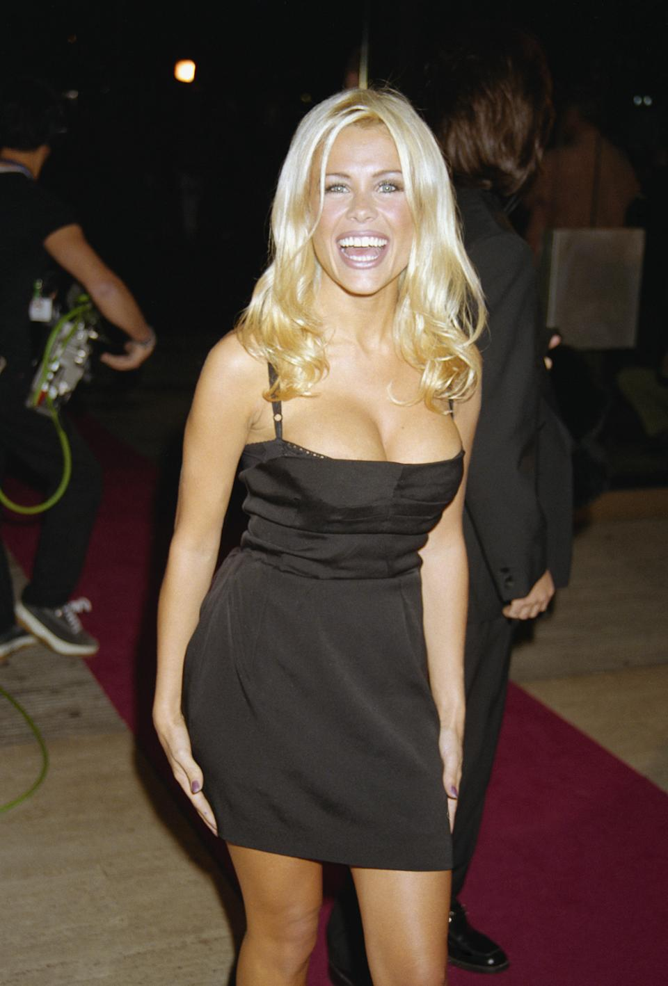 English glamour model and television presenter Melinda Messenger arrives at the National Television Awards at the Royal Albert Hall, 7th October 1997. (Photo by Dave Benett/Hulton Archive/Getty Images)