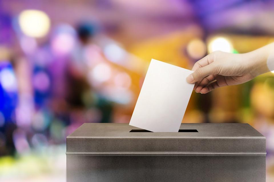 Person submitting their vote in a ballot box Emmys Facts