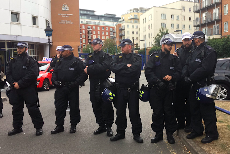Police have formed a human barrier outside the station: Mirren Gida/Twitter