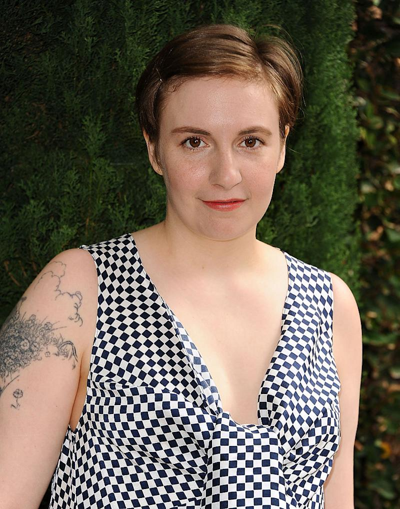 Lena Dunham sporting an upper-arm tattoo