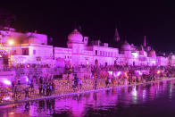 Hindu devotees gather while lighting earthen lamps on the banks of the River Sarayu on the eve before the groundbreaking ceremony of the proposed Ram Temple in Ayodhya on August 4, 2020. - India's Prime Minister Narendra Modi will lay the foundation stone for a grand Hindu temple in a highly anticipated ceremony at a holy site that was bitterly contested by Muslims, officials said. (Photo by SANJAY KANOJIA / AFP)