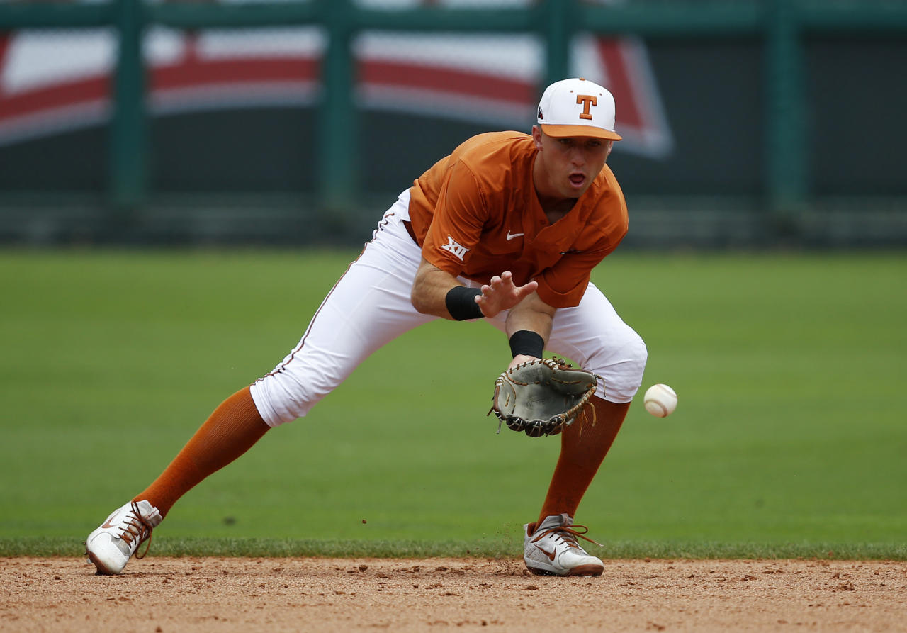 File- This May 22, 2018, file photo shows Texas infielder Kody Clemens, fielding a ball during batting practice before the Big 12 Baseball Tournament in Oklahoma City. The Detroit Tigers have selected Clemens, the son of seven-time Cy Young winner Roger Clemens, to lead off the second day of the Major League Baseball draft Tuesday, June 5, 2018. The younger Clemens was the Big 12 player of the year, and has helped the Longhorns to the NCAA Tournament super regionals. He is hitting a team-leading .346 with 21 home runs and 68 RBIs as one of college baseball's top sluggers.(AP Photo/Sue Ogrocki, File)
