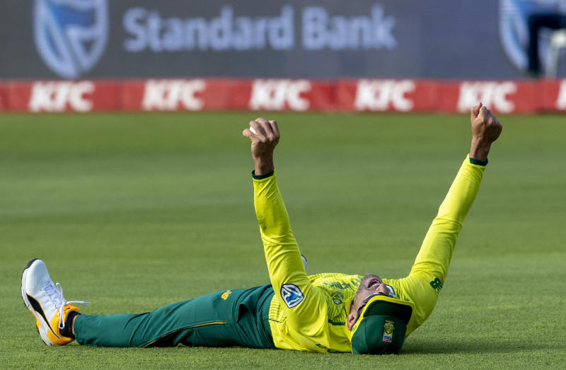 South Africa's Faf du Plessis reacts after taking a catch and dismissing Australia's batsman Steven Smith for 29 runs during the 2nd T20 cricket match between South Africa and Australia at St George's Park in Port Elizabeth, South Africa, Sunday, Feb. 23, 2020. (AP Photo/Themba Hadebe)