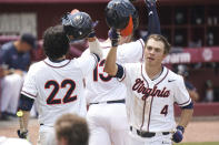Virginia's Nic Kent (4) celebrates his fourth inning home run with Jake Gelof (22) during an NCAA college baseball tournament super regional game against Dallas Baptist on Monday, June 14, 2021, in Columbia, S.C. (AP Photo/Sean Rayford)