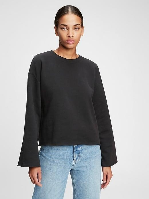 <p>For a subtle twist on a classic style, grab this <span>Gap Cropped Flare Sleeve Sweatshirt</span> ($20, originally $50) instead.</p>