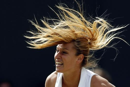 10ThingstoSeeSports - Domimika Cibulkova, of Slovakia, serves to Lucie Safarova, of Czech Republic, during their women's singles match at the All England Lawn Tennis Championships in Wimbledon, London, Friday, June 27, 2014. (AP Photo/Alastair Grant, File)