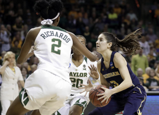 Baylor guard Didi Richards (2) and Juicy Landrum (20) defend as Michigan guard Katelynn Flaherty (3) works for a shot attempt in the first half of a second-round game at the NCAA women's college basketball tournament in Waco, Texas, Sunday, March 18, 2018. (AP Photo/Tony Gutierrez)