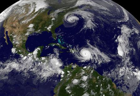 Hurricane Maria which bore down menacingly on the Virgin Islands and Puerto Rico on Tuesday after devastating the tiny island nation of Dominica and Hurricane Jose (top) are both seen in the Atlantic Ocean in this NOAA's GOES East satellite image taken at 21:45 p.m. EDT on September 19, 2017 (0145 UTC, September 20, 2017).     Courtesy NASA/NOAA GOES Project/Handout via REUTERS