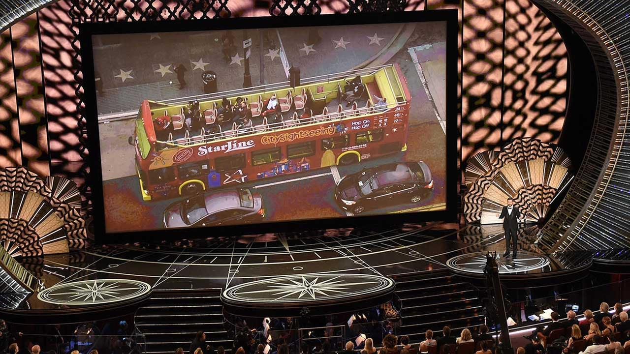 Unsuspecting tourists aboard a Hollywood tour bus were treated to the surprise of their lives with a trip to the 89th Oscars ceremony.