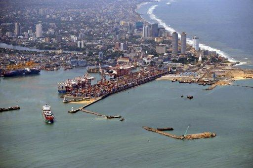 "Photo illustration shows the port of Colombo. An oil slick from a rusting cargo vessel that sank in bad weather reached the coast of Sri Lanka's capital Saturday, but officials insisted the spill was ""manageable"" and could easily be cleaned up"