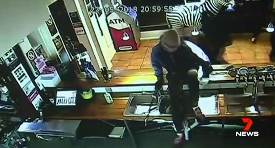 The group rifled through the registers and safe, looking for the day's takings. Source: 7 News