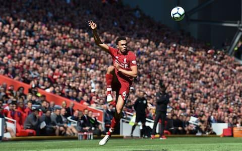 Liverpool's English defender Trent Alexander-Arnold plays the ball during the English Premier League football match between Liverpool and Wolverhampton Wanderers at Anfield in Liverpool - Credit: AFP