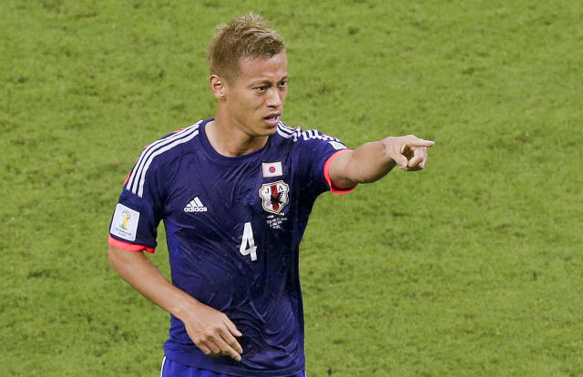 Japan's Keisuke Honda celebrates scoring the opening goal during the group C World Cup soccer match between Ivory Coast and Japan at the Arena Pernambuco in Recife, Brazil, Saturday, June 14, 2014. (AP Photo/Hassan Ammar)