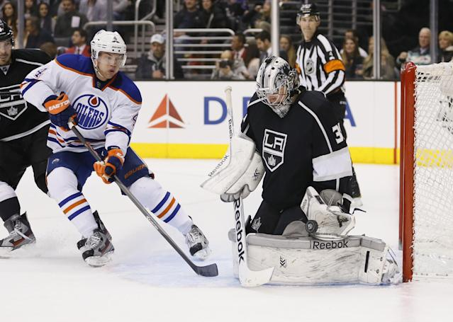 Los Angeles Kings' goaltender Martin Jones, right, makes a save as Edmonton Oilers' Taylor Hall, left, looks for a rebound, during the third period of an NHL hockey game in Los Angeles, Tuesday, Dec. 17, 2013. The Kings won 3-0. (AP Photo/Danny Moloshok)