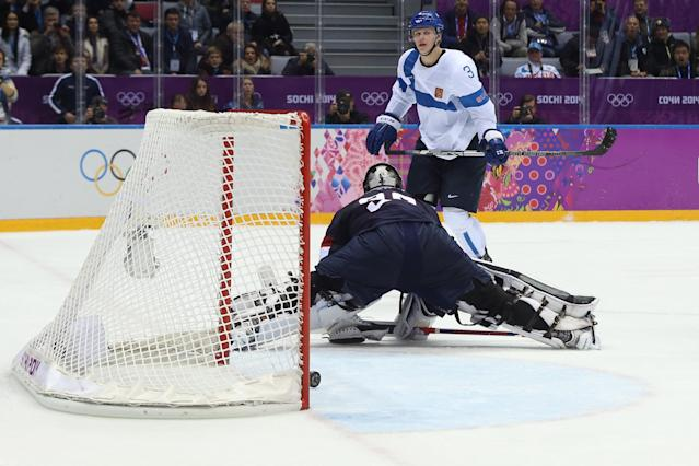 SOCHI, RUSSIA - FEBRUARY 22: Olli Maatta #3 of Finland scores against Jonathan Quick #32 of the United States in the third period during the Men's Ice Hockey Bronze Medal Game on Day 15 of the 2014 Sochi Winter Olympics at Bolshoy Ice Dome on February 22, 2014 in Sochi, Russia. (Photo by Bruce Bennett/Getty Images)