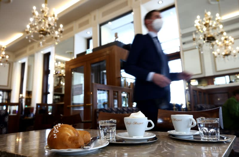 Coffee and a pastry are seen on a table inside Cafe Mozart in Vienna