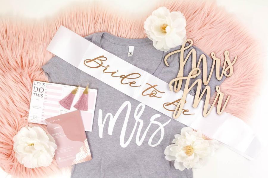 """This monthly subscription box is packed with wedding vibes. Products include wedding planning journals, thank you cards, jewelry, makeup, apparel toting your new status as a future Mrs., and more. The overall value is $120 (or more), so it's a <em>great</em> deal. $49.95, Maeven Bridal Box. <a href=""""https://www.maevenbox.com/collections/bride-box-subscribe/products/bride-box-subscription-month-to-month"""" rel=""""nofollow noopener"""" target=""""_blank"""" data-ylk=""""slk:Get it now!"""" class=""""link rapid-noclick-resp"""">Get it now!</a>"""