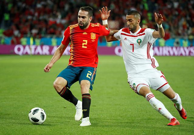 Soccer Football - World Cup - Group B - Spain vs Morocco - Kaliningrad Stadium, Kaliningrad, Russia - June 25, 2018 Spain's Dani Carvajal in action with Morocco's Hakim Ziyech REUTERS/Christian Hartmann