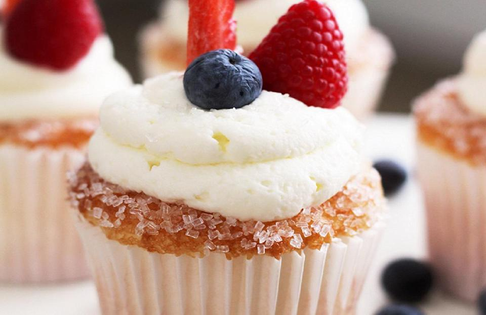 """<p>Do more with your <a href=""""https://www.thedailymeal.com/cook/13-things-you-didnt-know-you-could-make-boxed-cake-mix-slideshow?referrer=yahoo&category=beauty_food&include_utm=1&utm_medium=referral&utm_source=yahoo&utm_campaign=feed"""" rel=""""nofollow noopener"""" target=""""_blank"""" data-ylk=""""slk:boxed cake mix"""" class=""""link rapid-noclick-resp"""">boxed cake mix</a> by creating these pretty cupcakes. Simply bake angel food cake mix, add a crunchy sugar outer layer and pipe on mascarpone frosting. Complete the cupcakes with raspberries, blueberries and strawberries on top for a pop of color.</p> <p><a href=""""https://www.thedailymeal.com/recipes/berries-cloud-cupcakes-recipe?referrer=yahoo&category=beauty_food&include_utm=1&utm_medium=referral&utm_source=yahoo&utm_campaign=feed"""" rel=""""nofollow noopener"""" target=""""_blank"""" data-ylk=""""slk:For the Berries on a Cloud Cupcakes recipe, click here."""" class=""""link rapid-noclick-resp"""">For the Berries on a Cloud Cupcakes recipe, click here.</a></p>"""