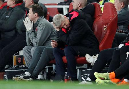 FILE PHOTO: Soccer Football - Europa League Round of 16 Second Leg - Arsenal vs AC Milan - Emirates Stadium, London, Britain - March 15, 2018 Arsenal manager Arsene Wenger reacts REUTERS/David Klein/File Photo