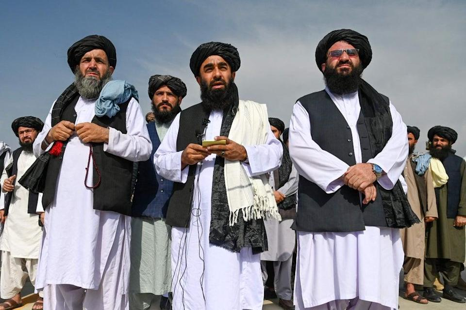 Taliban spokesman Zabihullah Mujahid speaks to the media at the airport in Kabul on August 31 (AFP via Getty Images)