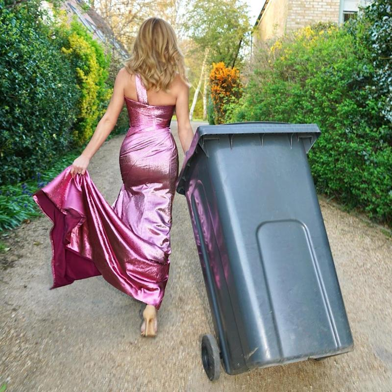 Amanda Holden taking out the bins in a purple couture dress